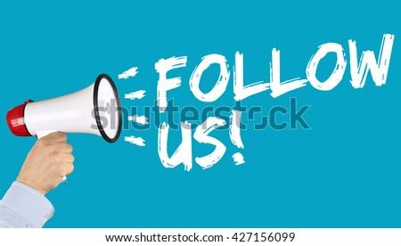 Follow us follower followers fans likes social networking media internet hand with megaphone - stock photo