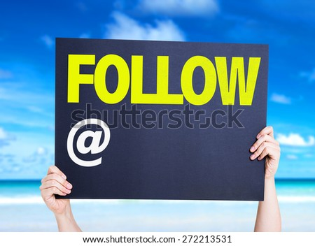 Follow with a copy space card with beach background - stock photo