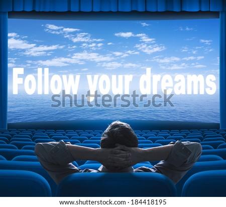 follow your dreams phrase on cinema screen - stock photo