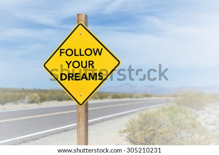 Follow your dreams road sign, message on the road - stock photo