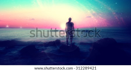 Follow your dreams, silhouette of man and many stars, rising sun on the beach, alien landscape- elements of this image are furnished by NASA - stock photo