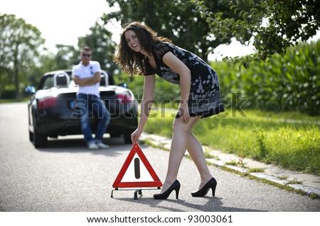 Following a breakdown warning triangle - stock photo