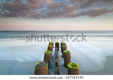 Folly Beach Charleston South Carolina Erosion Control Timber Groin at Sunset - stock photo