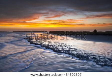Folly Beach Ocean Sunset Charleston SC Landscape seascape scene in South Carolina - stock photo