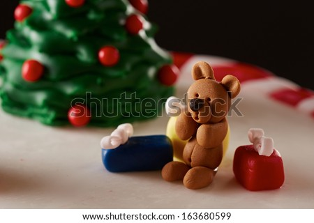 Fondant Christmas tree cake with a kid and presents detail - stock photo