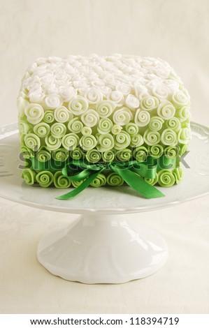 Fondant rose wedding cake - stock photo