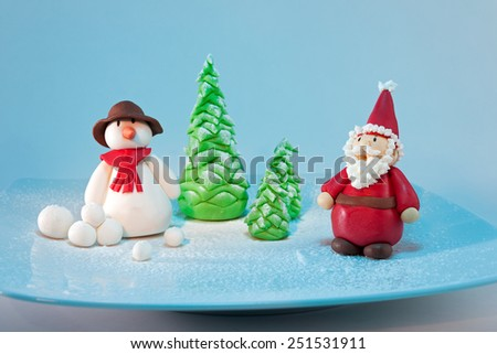 Fondant santa and snowman characters - stock photo