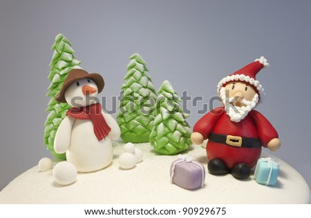 Fondant snowman and santa characters - stock photo