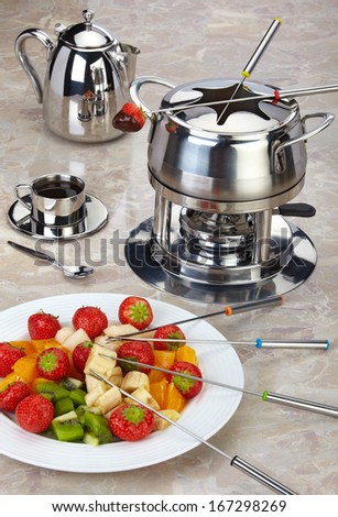 Fondue set with strawberries, fruit and chocolate