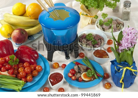 fondue with meat and vegetables - stock photo