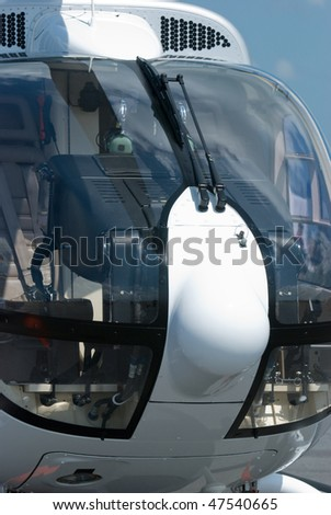 Font detail with cockpit of white helicopter - stock photo