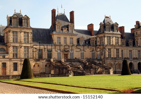 Fontainebleau Castle with garden in front - stock photo