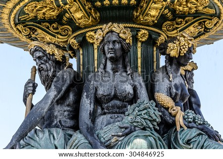 Fontaines de la Concorde (designed by Jacques Ignace Hittorff, 1840) on Place Concorde in Paris, France. North fountain commemorates navigation and commerce on the rivers of France. - stock photo