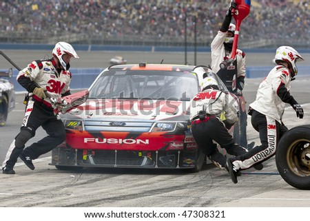 Fontana, CA - FEB 21, 2010:  Greg Biffle brings his 3M Ford Fusion in for service during the Auto Club 500 race a the Auto Club Speedway in Fontana, CA on Feb 21, 2010 - stock photo