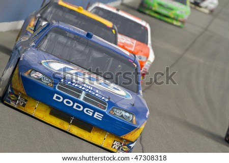 Fontana, CA - FEB 21, 2010:  Kurt Busch brings his Miller Lite Dodge through the turns during the Auto Club 500 race a the Auto Club Speedway in Fontana, CA on Feb 21, 2010