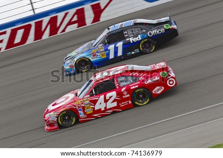 FONTANA, CA - MAR 27:  Denny Hamlin (11) and Juan Pablo Montoya (42) battle for position during the Auto Club 400 NASCAR Sprint Cup race at the Auto Club Speedway in Fontana, CA on Mar 27, 2011. - stock photo