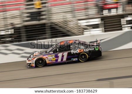 FONTANA, CA - MAR 22: Denny Hamlin at the Nascar Sprint Cup at Auto Club Speedway in Fontana, CA on March 22, 2014