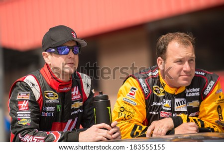 FONTANA, CA - MAR 23: Kurt Busch (left) and Ryan Newman at the Nascar Sprint Cup Auto Club 400 race at Auto Club Speedway in Fontana, CA on March 23, 2014 - stock photo