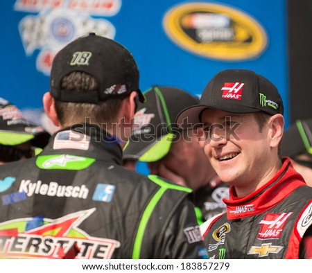 FONTANA, CA - MAR 23: Kurt Busch (right) congratulates his brother Kyle Busch after winning the  Nascar Sprint Cup Auto Club 400 race at Auto Club Speedway in Fontana, CA on March 23, 2014 - stock photo