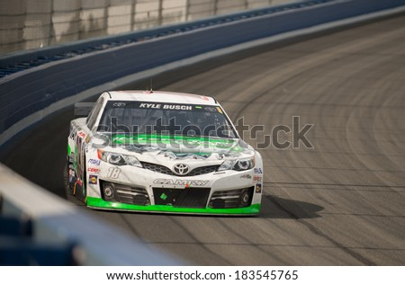 FONTANA, CA - MAR 23: Kyle Busch in turn 3 at the Nascar Sprint Cup Auto Club 400 race at Auto Club Speedway in Fontana, CA on March 23, 2014 - stock photo