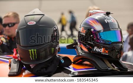 FONTANA, CA - MAR 23: Kyle Busch's and Denny Hamlin's (right) helmets Nascar Sprint Cup Auto Club 400 race at Auto Club Speedway in Fontana, CA on March 23, 2014 - stock photo
