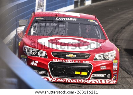 Fontana, CA - Mar 22, 2015:  Kyle Larson (42) brings his race car through the turns during the  race at the Auto Club Speedway in Fontana, CA. - stock photo