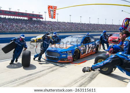 Fontana, CA - Mar 22, 2015:  Ricky Stenhouse Jr. (17) comes in for service during the Auto Club 400 race at the Auto Club Speedway in Fontana, CA. - stock photo