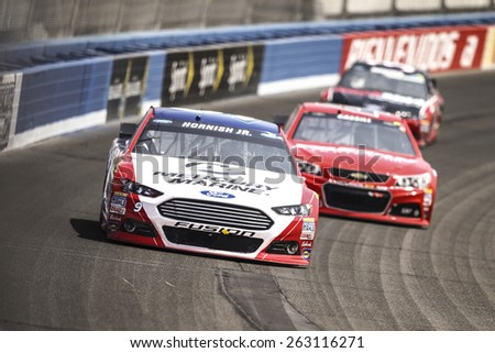 Fontana, CA - Mar 22, 2015:  Sam Hornish Jr. (9) brings his race car through the turns during the  race at the Auto Club Speedway in Fontana, CA. - stock photo