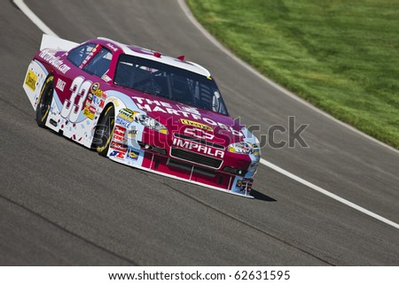 FONTANA, CA - OCT 08, 2010:  Clint Bowyer brings his Hartford Chevrolet through the turns during a practice session for the Pepsi Max 400 race at the Auto Club Speedway in Fontana, CA on Oct 8, 2010.