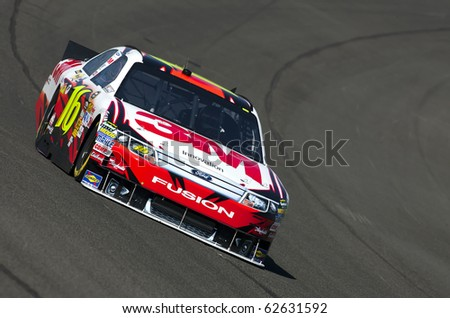 FONTANA, CA - OCT 08, 2010:  Greg Biffle brings his 3M Ford Fusion through the turns during a practice session for the Pepsi Max 400 race at the Auto Club Speedway in Fontana, CA on Oct 8, 2010. - stock photo