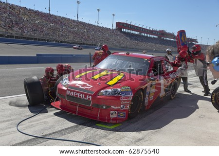 FONTANA, CA - OCT 10:  Jamie McMurray brings his McDonald's Chevrolet in for service during the Pepsi Max 400 race at the Auto Club Speedway in Fontana, CA on Oct 10, 2010. - stock photo