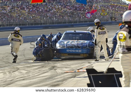 FONTANA, CA - OCT 10:  Kurt Busch brings his crippled Miller Lite Dodge in for service during the Pepsi Max 400 race at the Auto Club Speedway in Fontana, CA on Oct 10, 2010. - stock photo