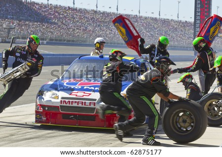 FONTANA, CA - OCT 10:  Mark Martin brings his CarQuest Auto Parts Chevrolet in for service during the Pepsi Max 400 race at the Auto Club Speedway in Fontana, CA on Oct 10, 2010. - stock photo