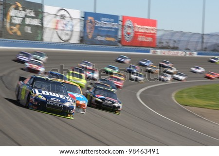FONTANA, CA. - OCT 10: Sprint Cup Series driver Jimmie Johnson in the Lowe's #48 car leads out of turn 2 during the Pepsi Max 400 on Oct 10 2010 at the Auto Club Speedway.