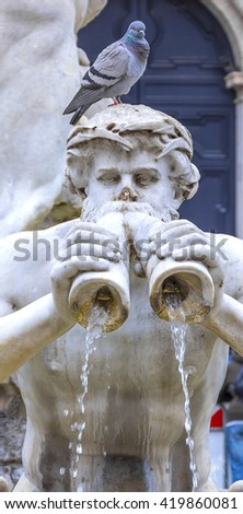 Fontana del Moro (Moor Fountain) is a fountain located at the southern end of the Piazza Navona in Rome, Italy. It represents a Moor wrestling with a dolphin, surrounded by four Tritons. - stock photo