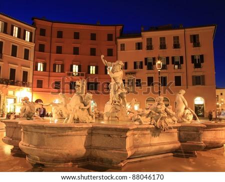 Fontana del Nettuno (Fountain of Neptune) at night, Piazza Navona, Rome, Italy - stock photo
