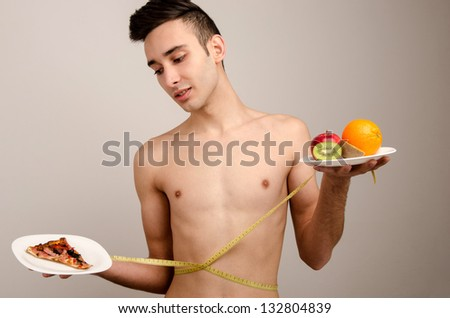 Food, a choice for your health. Bad food versus good food. - stock photo
