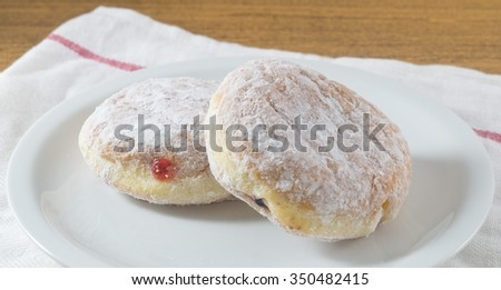 Food and Bakery, Two Glazed Sweet Donuts Strawberry Jam and Blueberry Jam with Icing Toppings. - stock photo
