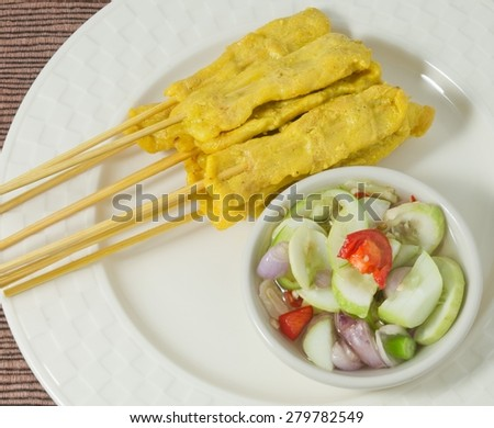 Food and Cuisine, Delicious Grilled Pork Satay on Bamboo Skewer Served with Cucumber Salad. - stock photo