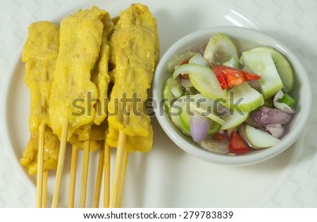 Food and Cuisine, Grilled Pork Satay on Bamboo Stick Served with Cucumber Salad. - stock photo
