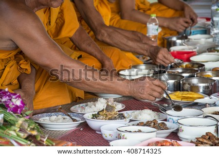 food and drink for monks in traditional religious ceremony in a temple , Thailand. - stock photo