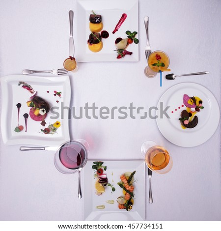 Food and drink, restaurant. Desserts and drinks symmetrically served on white table. - stock photo