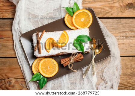 Food and drink, still life concept. Home made orange cake with citrus fruits on a wooden table. Selective focus, top view - stock photo
