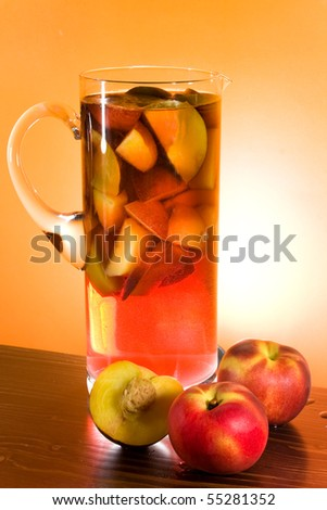 Food And Drinks - Jug with sangria and peaches. - stock photo