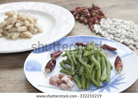 Food and health: vegetables. French beans with bacon - stock photo