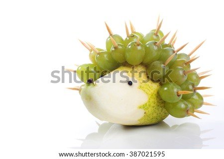 Food art creative concepts. Funny and cute hedgehog made of pear and green grapes isolated on a white background. - stock photo
