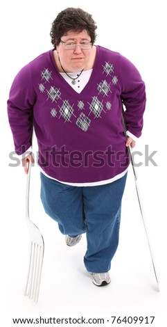 Food as Crutch Concept overweight woman with giant knife and fork used as crutches.  Over white with clipping path.