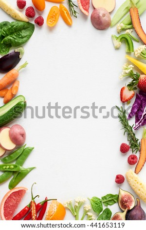 Food background border frame flat lay overhead of colorful fresh produce raw vegetables, carrot chilli cucumber purple cabbage spinach rosemary herb, plenty of copy-space in middle - stock photo