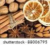 food background. chocolate, cinnamon sticks, anise stars, nuts and sliced of dried orange - stock photo