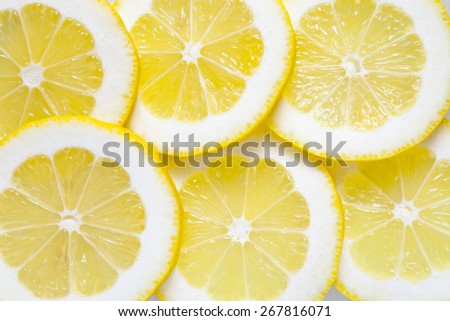 Food background from slices of yellow lemon - stock photo